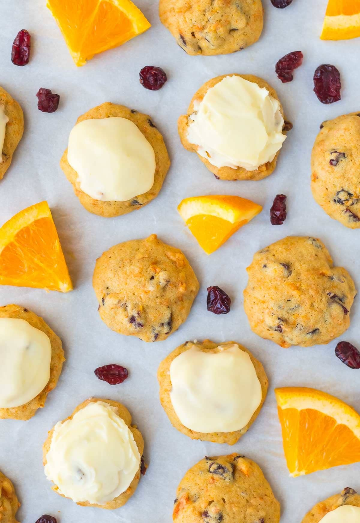 Melt in Your Mouth Cranberry Orange Cookies. Soft and pillowy with the BEST orange icing. Easy drop cookie recipe that's perfect for Christmas or anytime you want to bake. Recipe at wellplated.com   @wellplated