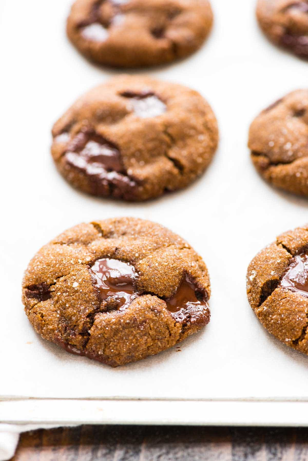 PERFECT Soft and Chewy Ginger Molasses Cookies with Dark Chocolate Chunks and fresh ginger. This is the BEST soft gingersnap recipe. Perfect for Christmas or anytime you want a special treat! Recipe at wellplated.com | @wellplated