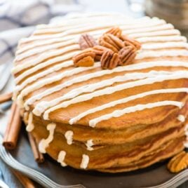 Soft and fluffy Gingerbread Pancakes with Maple Cream Cheese Drizzle. Tastes just like a gingerbread cookie! Easy recipe that's perfect for Christmas morning and holiday breakfasts. Recipe at wellplated.com | @wellplated