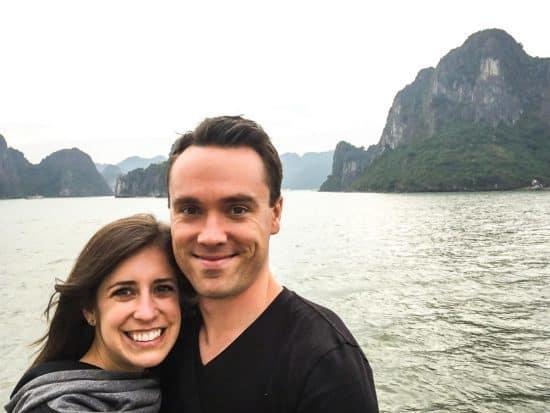 Erin and Ben Clarke standing near a lake