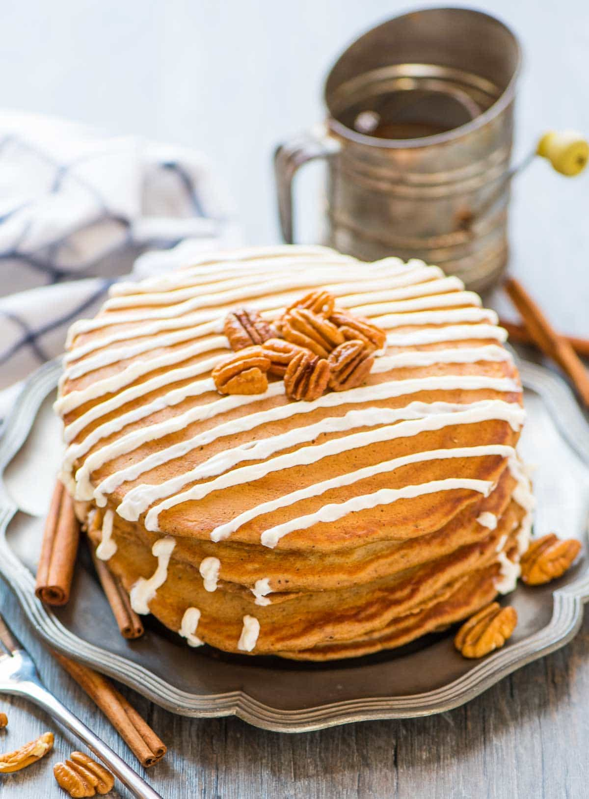 Light and fluffy Gingerbread Pancakes with Maple Cream Cheese Topping. The BEST Christmas breakfast! Easy recipe made without molasses. Recipe at wellplated.com | @wellplated