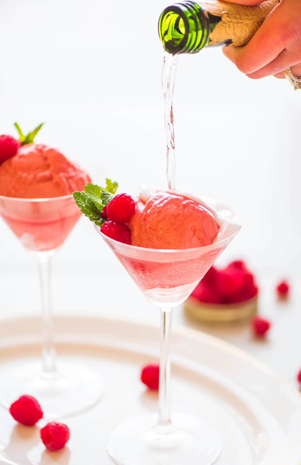 Raspberry Champagne Floats. TWO INGREDIENTS! A fun pink dessert-meets-cocktails for your next New Year's Eve, bachelorette party, bridal shower, or Valentine's Day. Recipe at wellplated.com | @wellplated