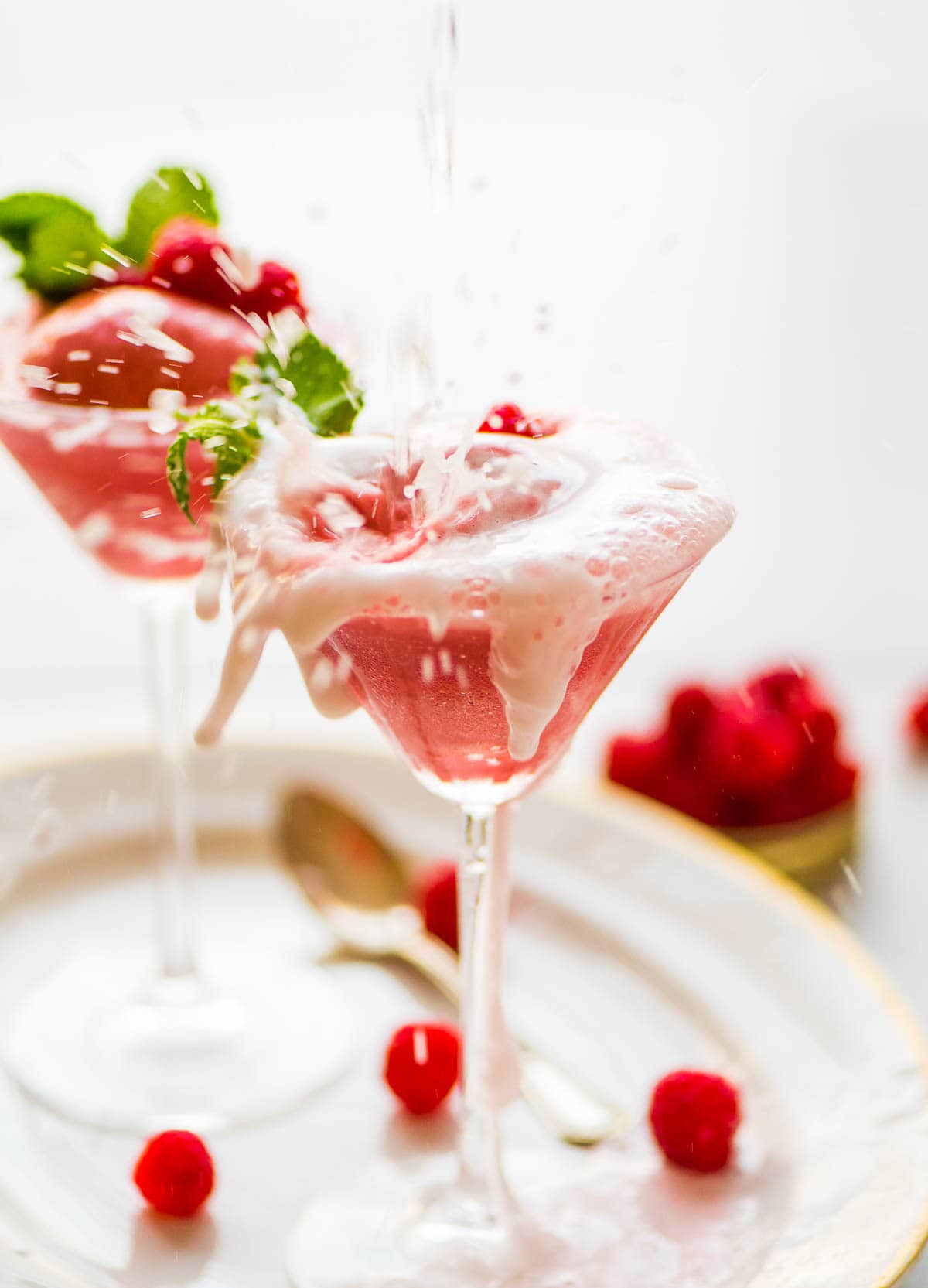 Raspberry Champagne Floats. An easy and fun pink dessert! Perfect for New Year's Eve, bachelorette parties, bridal showers, and more! Recipe at wellplated.com | @wellplated