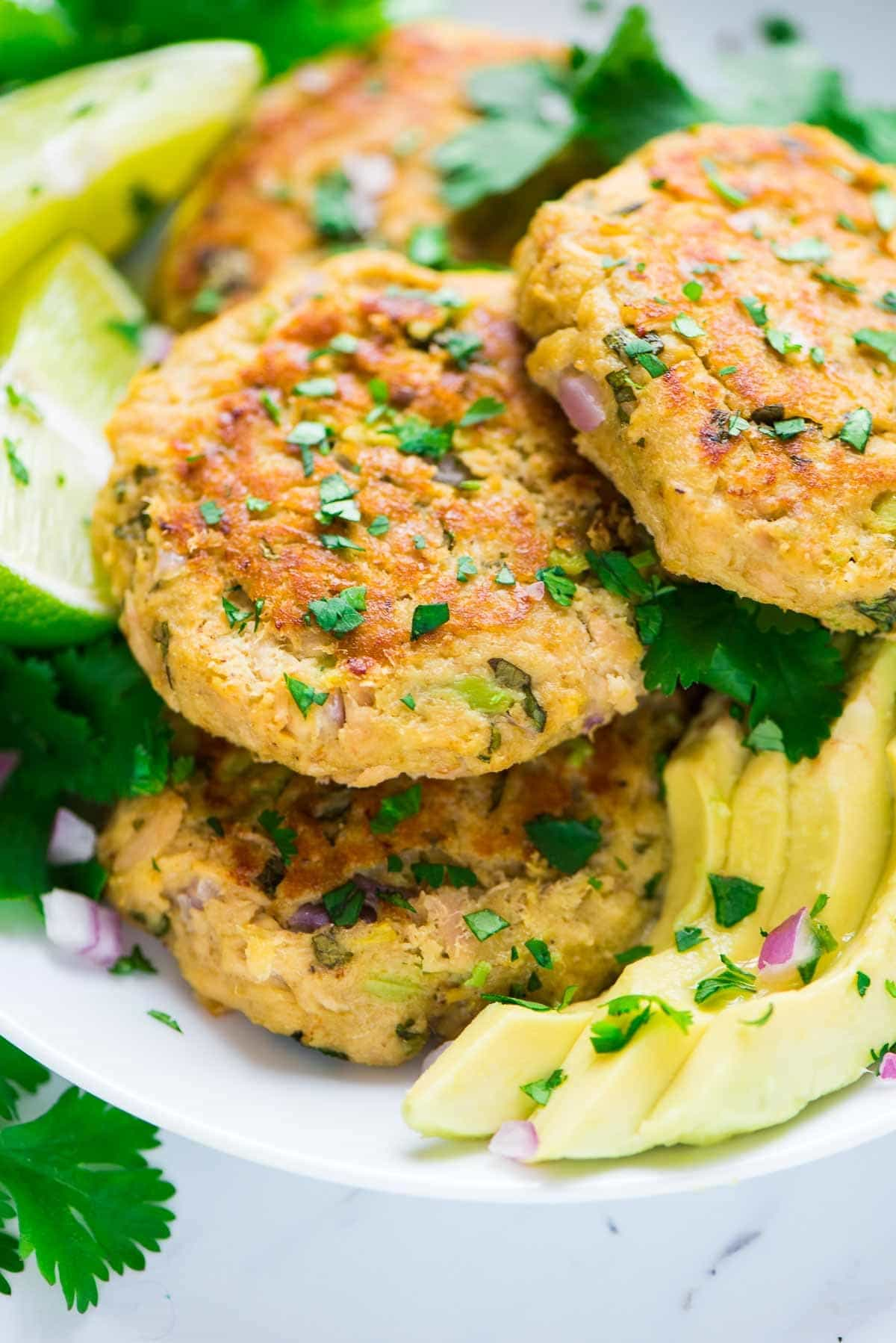 Baked Avocado Tuna Cakes. Quick, easy, and healthy. The best thing you can do with canned tuna! Budget-friendly, simple, and great for fast dinners and lunches. High protein, low carb recipe. wellplated.com   @wellplated