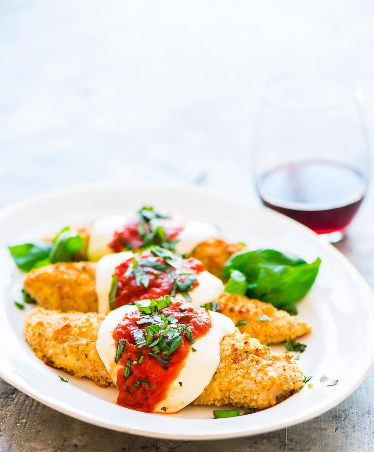 Skinny Baked Chicken Parmesan. The BEST! Easy, healthy recipe that our whole family loves. Recipe at wellplated.com | @wellplated