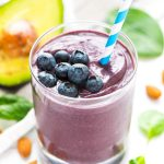 Hydrating Blueberry Banana Avocado Smoothie for glowing skin! With antioxidants and healthy fats from ingredients like spinach, blueberries, almond milk, avocados, and flax, this green smoothie is DELICIOUS and a natural way to promote beauty and health. Recipe at wellplated.com | @wellplated