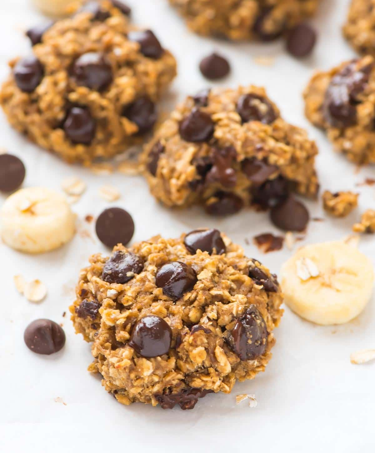 Soft and chewy Chocolate Chip Oatmeal Banana Cookies. NO BUTTER! The mashed banana makes them soft and moist without it. Perfect healthy dessert any time you have a craving. Recipe at wellplated.com | @wellplated