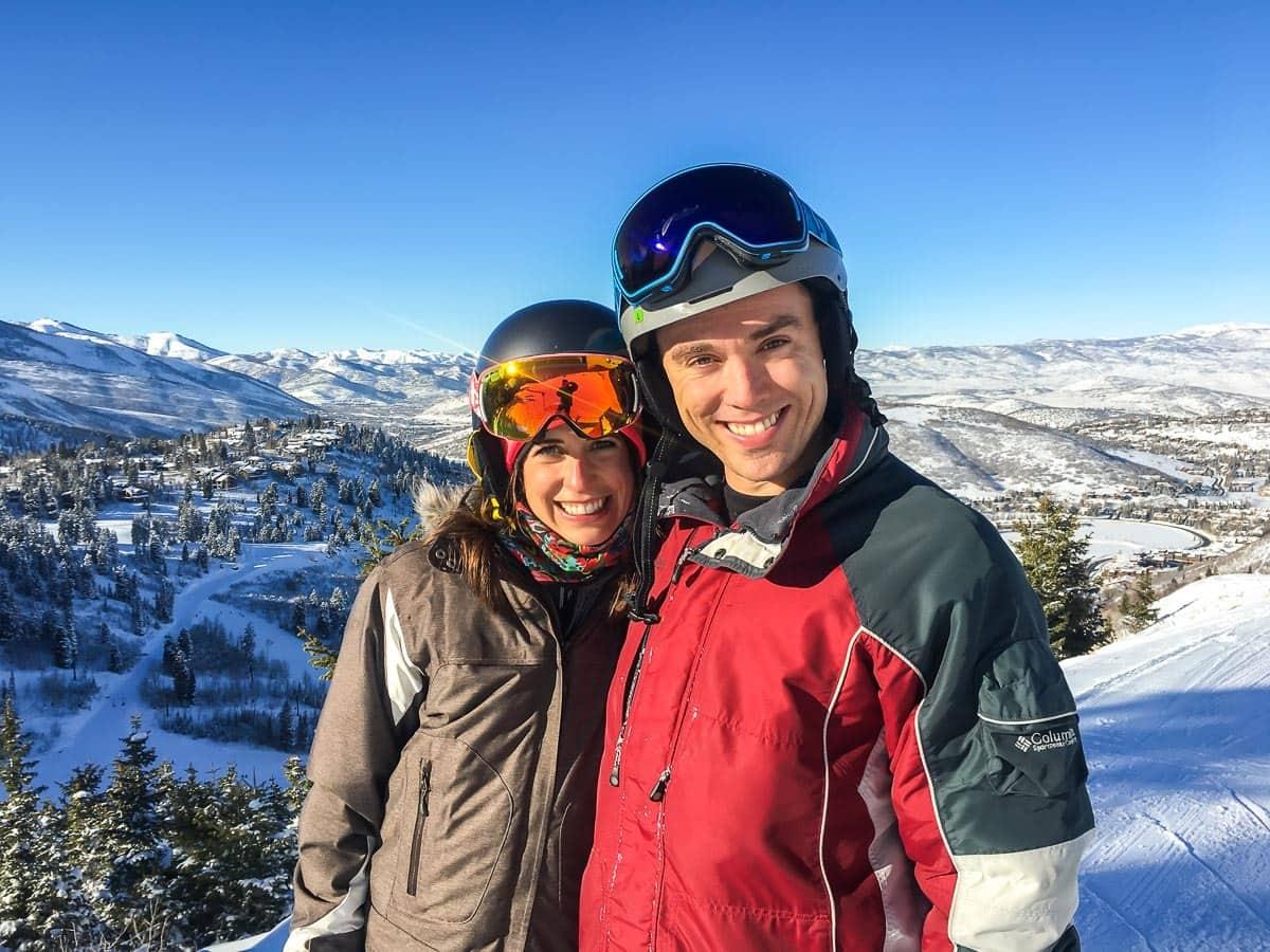 Erin and Ben Clarke in ski gear on a mountain