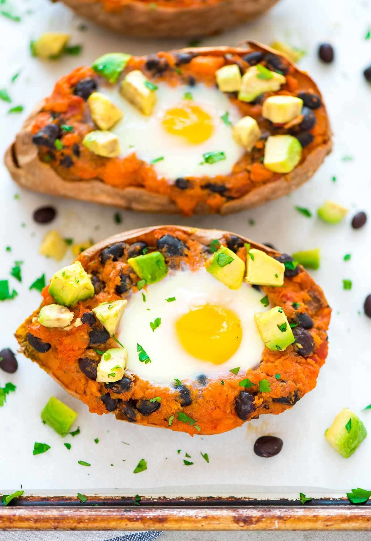 Twice Baked Mexican Stuffed Sweet Potatoes with black beans, avocado, and a runny egg. An easy, healthy recipe that's perfect anytime you need a quick dinner.