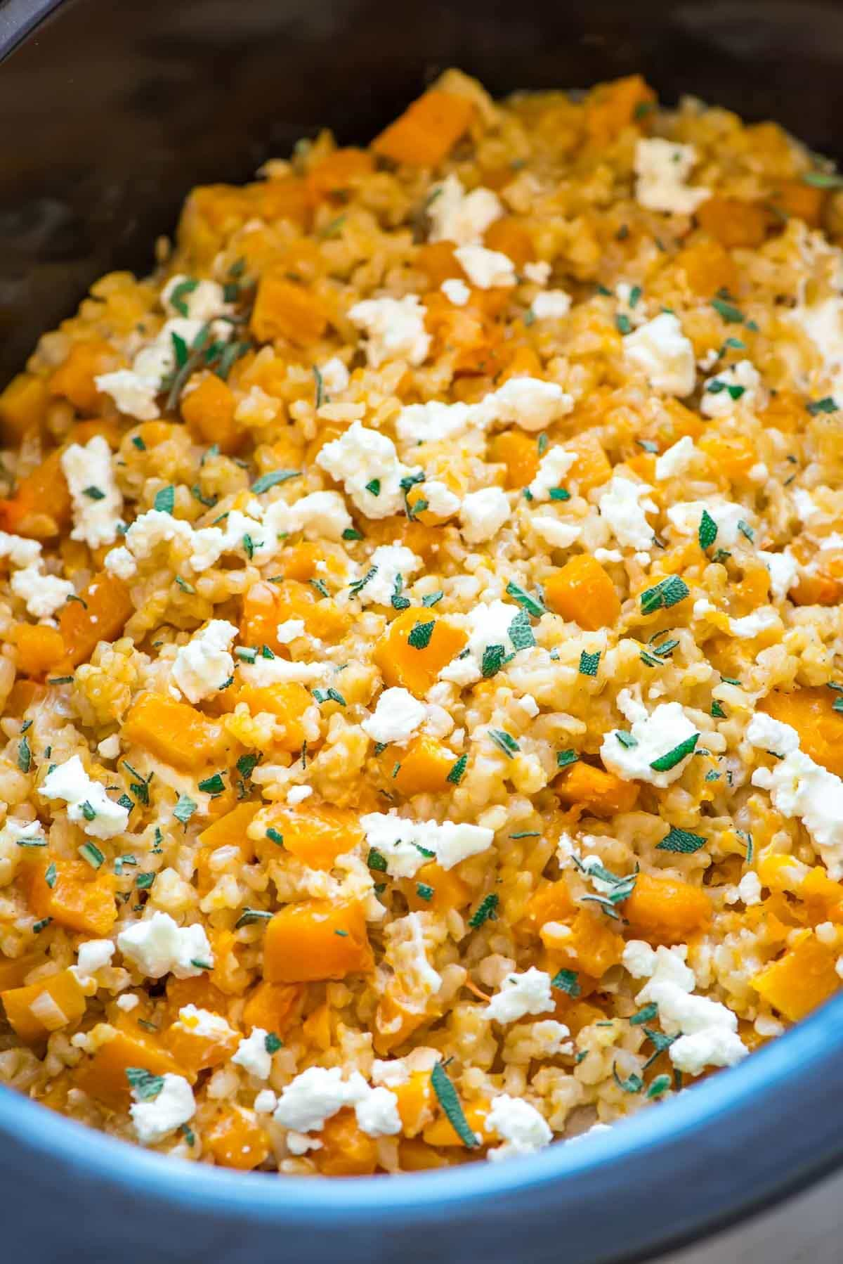 Slow Cooker Risotto with Butternut Squash, Goat Cheese and Sage. Creamy and delicious! Easy crock pot method with no stirring. Recipe uses brown rice, and you can add sausage, spinach, or anything else you like. Recipe at wellplated.com | @wellplated