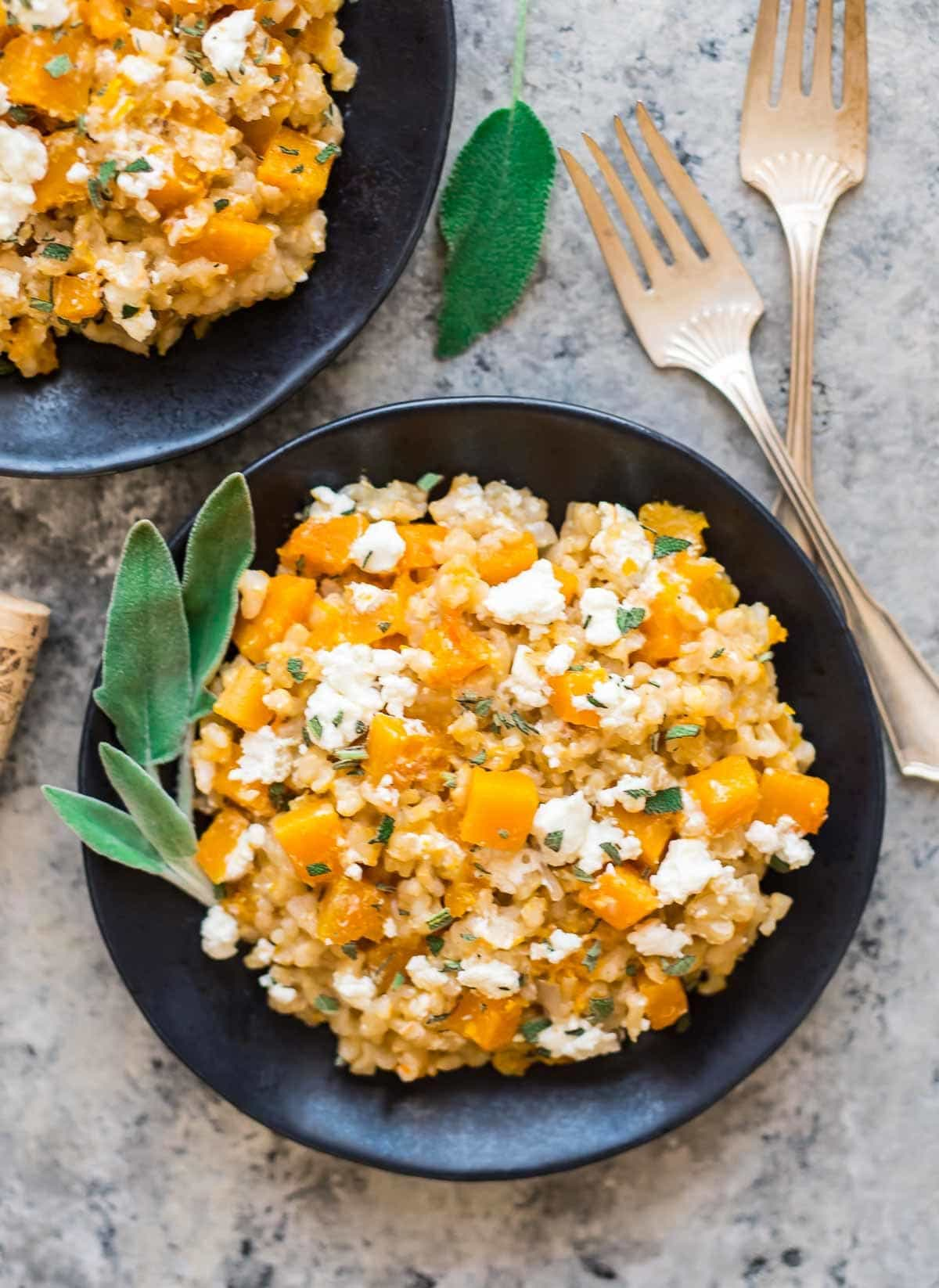 Healthy Slow Cooker Risotto with Butternut Squash, Goat Cheese, and Sage. This is the BEST risotto. Easy, no stir crock pot method with brown rice. Our whole family loved it! Recipe at wellplated.com | @wellplated