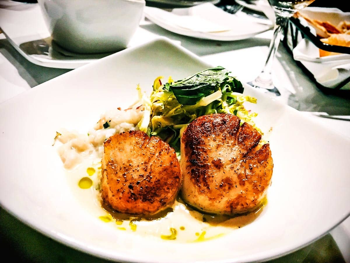 Two scallops on a plate at a restaurant