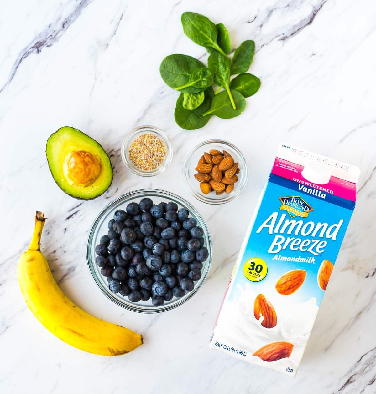 Hydrating Blueberry Avocado Banana Smoothie. Get bright, natural glowing skin with this delicious green smoothie recipe! Made with spinach, healthy fats, and antioxidants. Recipe at wellplated.com | @wellplated