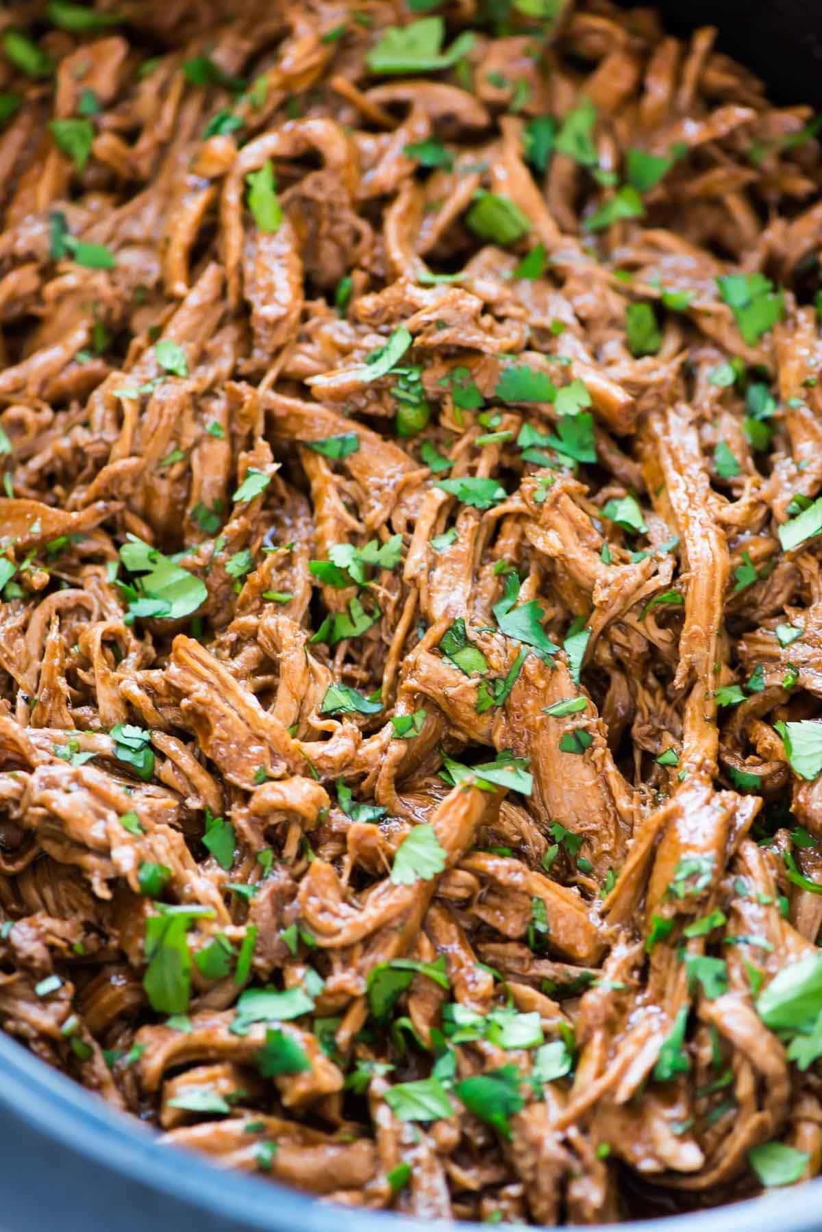 Slow Cooker Asian Pulled Pork Tacos with Slaw. This is our favorite slow cooker pulled pork recipe! Easy, delicious, and perfect for a crowd. Makes great leftovers too. Recipe at wellplated.com | @wellplated