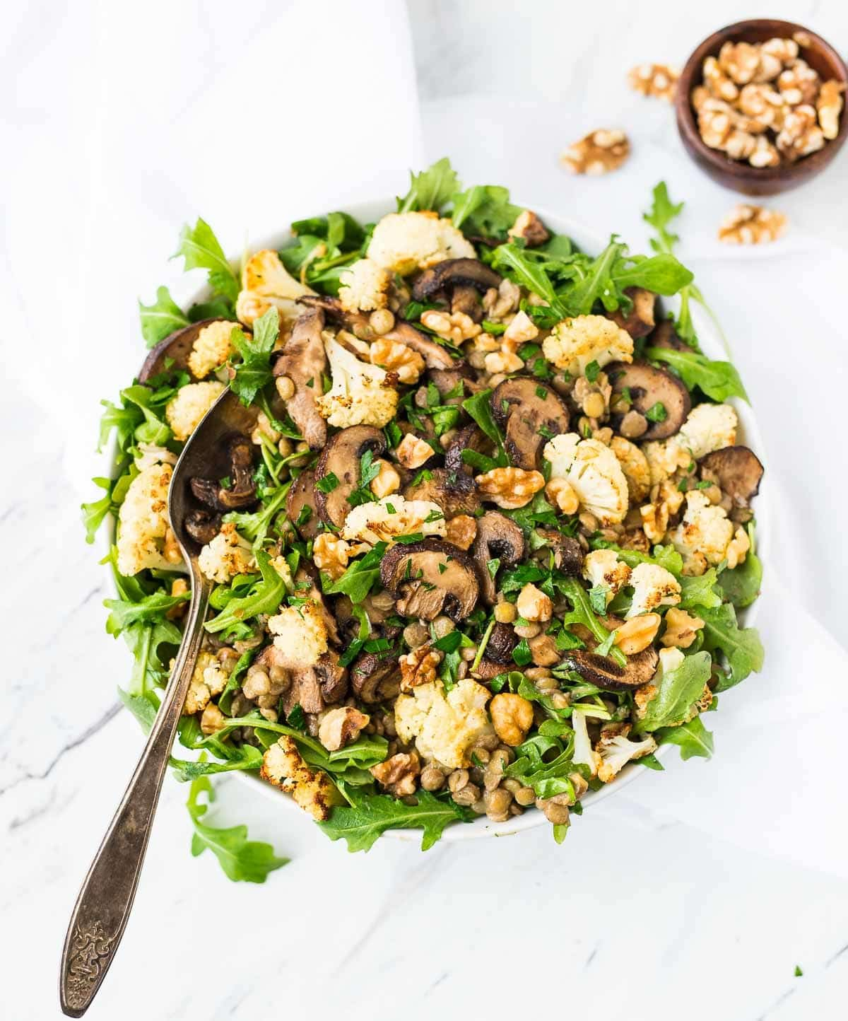 Lentil Salad with Roasted Cauliflower and Mushrooms. A healthy main dish salad that's easy to make, can be served warm or cold, and is PACKED with flavor. Great for a filling lunch or simple side. {vegan, gluten free} Recipe at wellplated.com | @wellplated