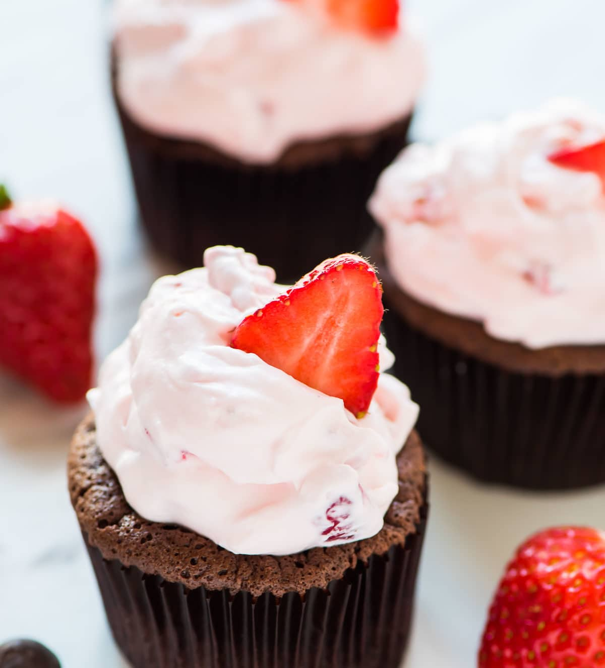 Chocolate Mousse Cupcakes. Rich, silky, chocolate cupcakes, topped with fluffy Strawberry Cream Cheese Frosting. TO DIE FOR! Recipe at wellplated.com   @wellplated