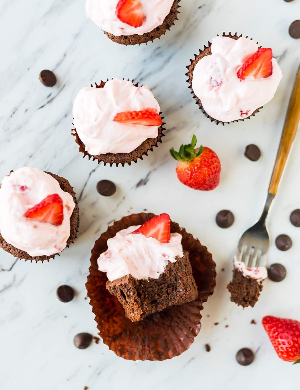 Chocolate Mousse Cupcakes with fresh strawberry cream cheese frosting. Easy gluten free dessert! Recipe at wellplated.com | @wellplated