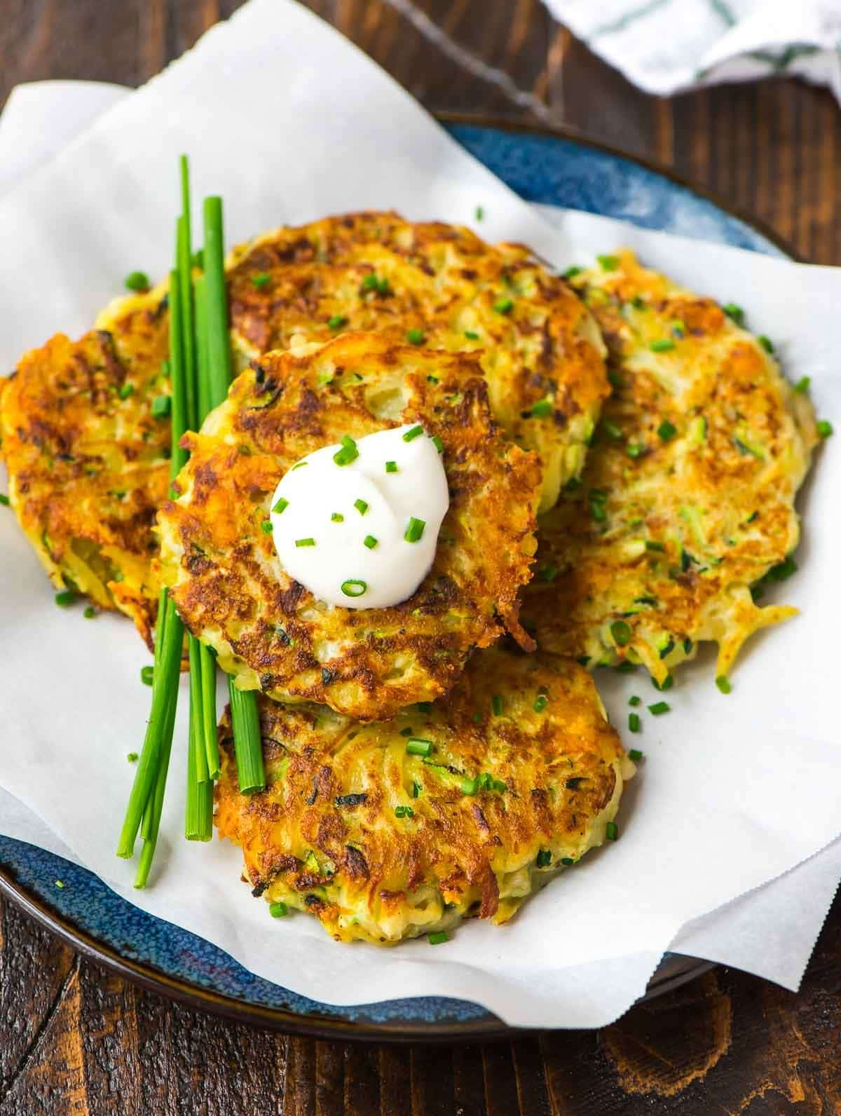 Potato Fritters with Zucchini and Cheese. Crispy, easy, and the BEST way to get picky eaters and kids to eat their veggies! Recipe at wellplated.com | @wellplated
