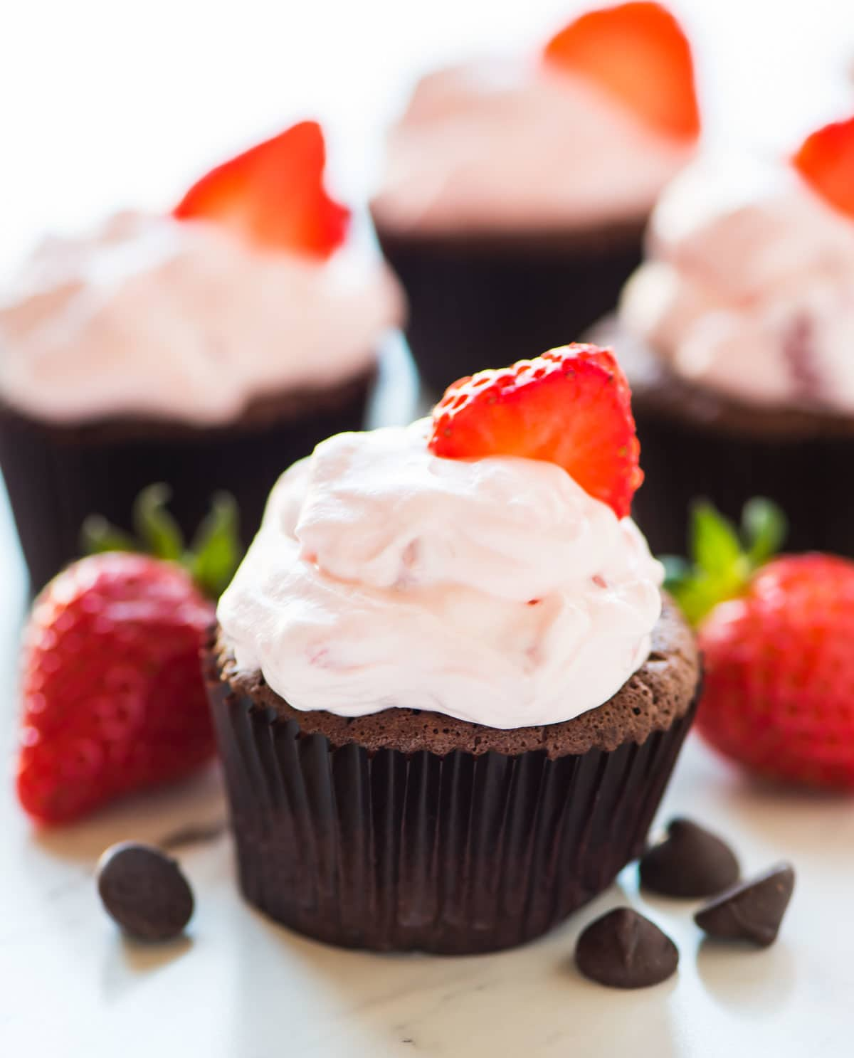 Easy Chocolate Mousse Cupcakes with Whipped Fresh Strawberry Cream Cheese Frosting. Rich, silky, and gluten free! Recipe at wellplated.com | @wellplated