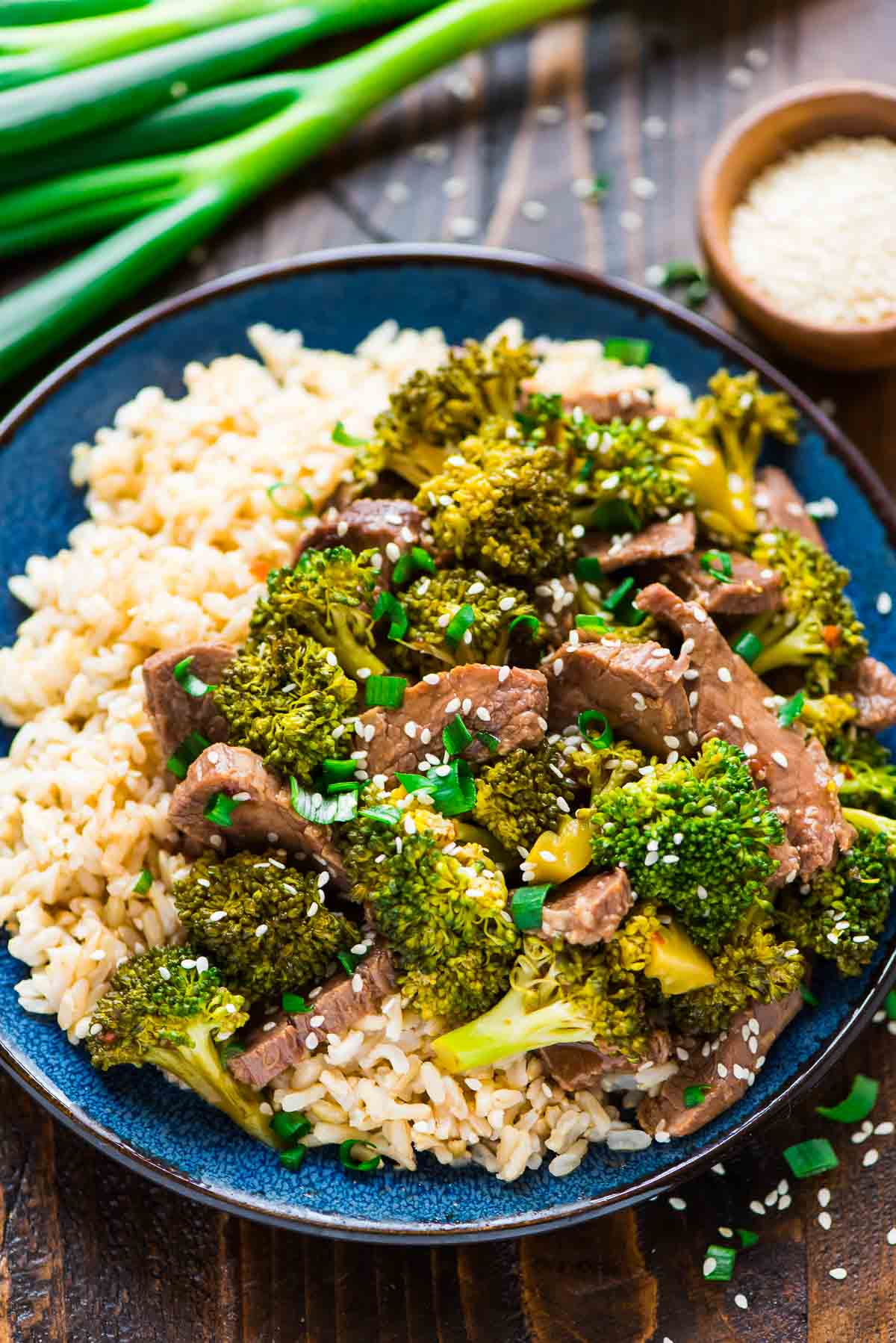 Slow cooker beef and broccoli well plated by erin plate of slow cooker beef and broccoli served over rice forumfinder Choice Image