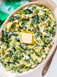 Paleo Colcannon. A healthy low carb version of traditional Irish colcannon that uses mashed cauliflower instead of potatoes. The green kale and onions make it a perfect recipe for St. Patrick's Day! {vegan, gluten free} Recipe at wellplated.com | @wellplated