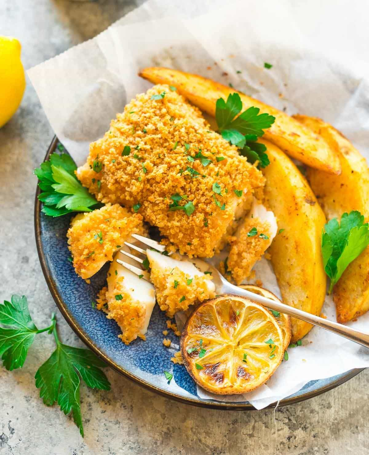 Healthy Oven Fried Fish and Chips. A baked fish and chips recipe that's crispy on the outside, tender and flaky on the inside and a family favorite. Quick and easy dinner recipe! Recipe at wellplated.com | @wellplated