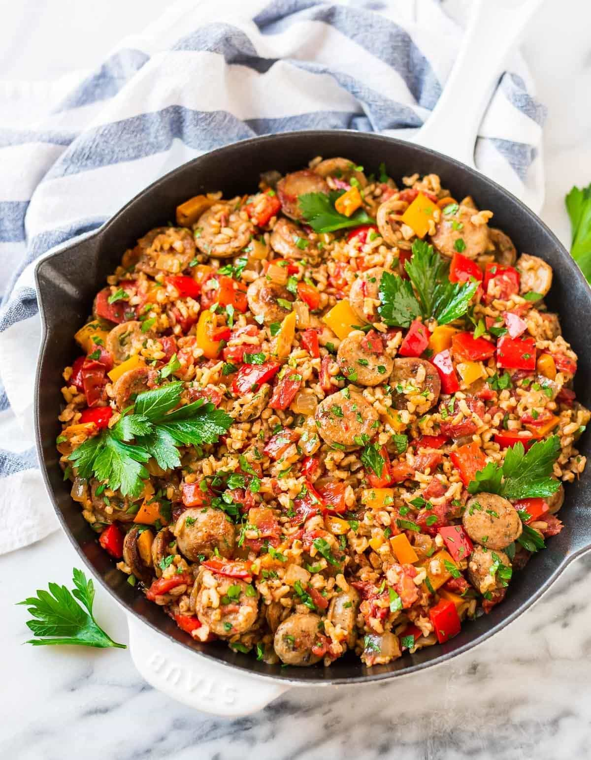 One pan sausage and rice casserole with bell peppers and fresh herbs