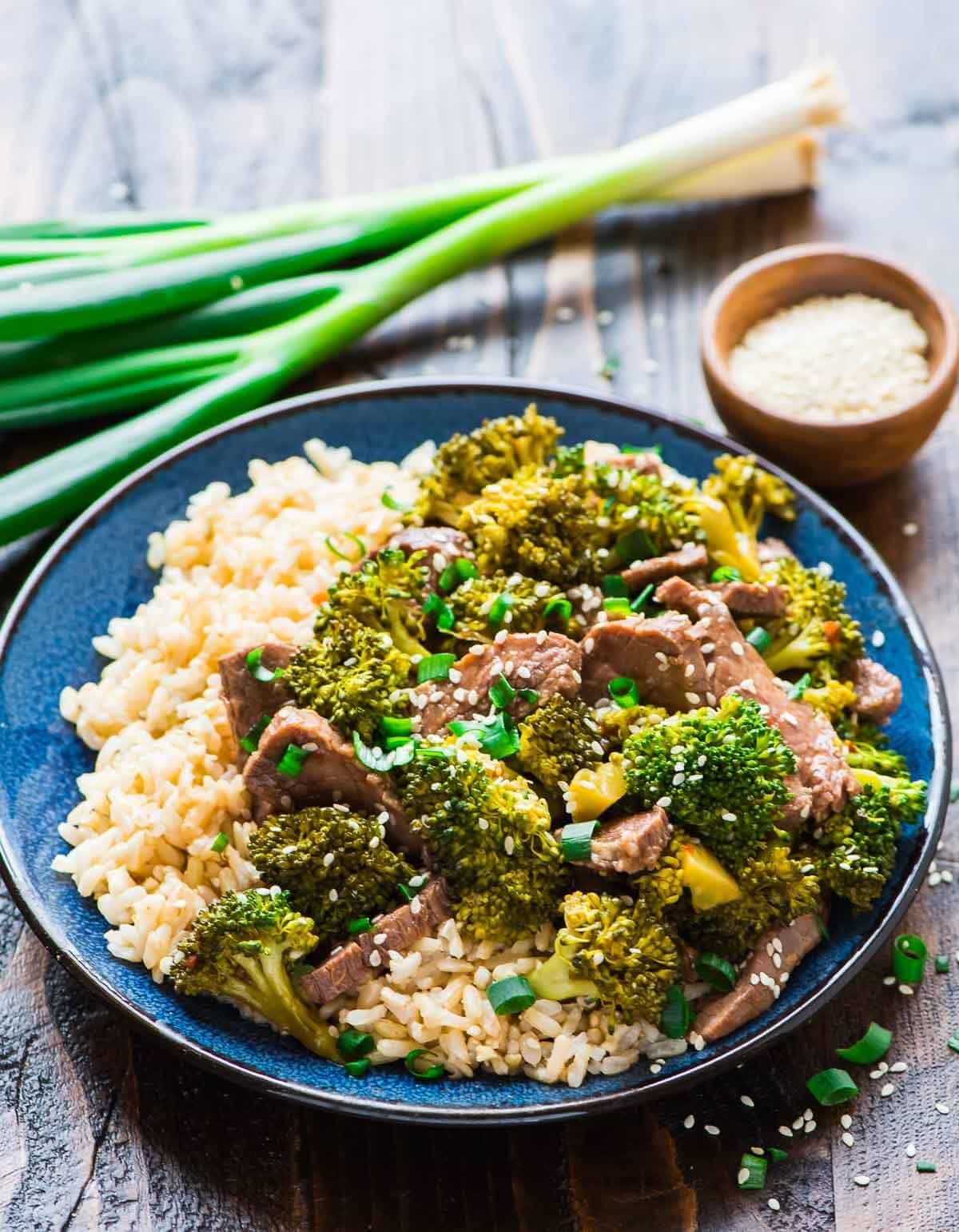 EASY Slow Cooker Beef and Broccoli Stir Fry. Healthy, low carb recipe. So much better than take out! Recipe at wellplated.com | @wellplated