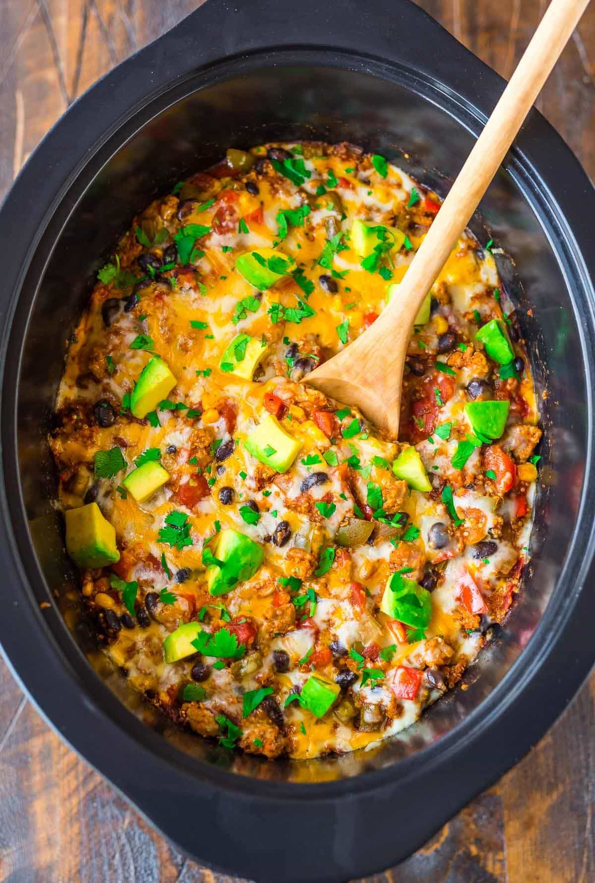 Cheesy Healthy Crock Pot Mexican Casserole with quinoa, black beans, fresh veggies, and ground chicken or turkey. Easy DELICIOUS comfort food! {gluten free} Recipe at wellplated.com | @wellplated
