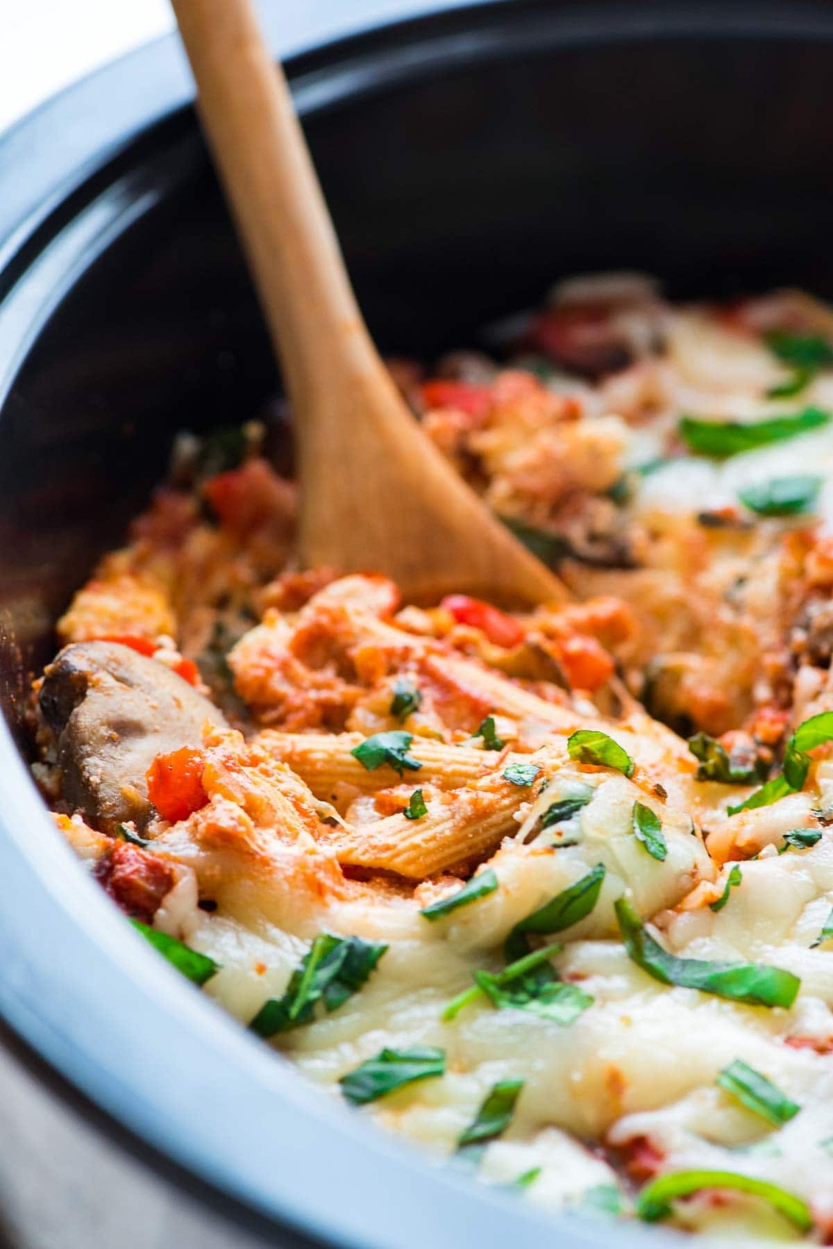 Crock Pot Pasta — the perfect dinner for a busy night! Easy, healthy, and the slow cooker does the work. Taste just like traditional baked penne, but is so much easier. Healthy, vegetarian recipe that our whole family loved. Recipe at wellplated.com | @wellplated