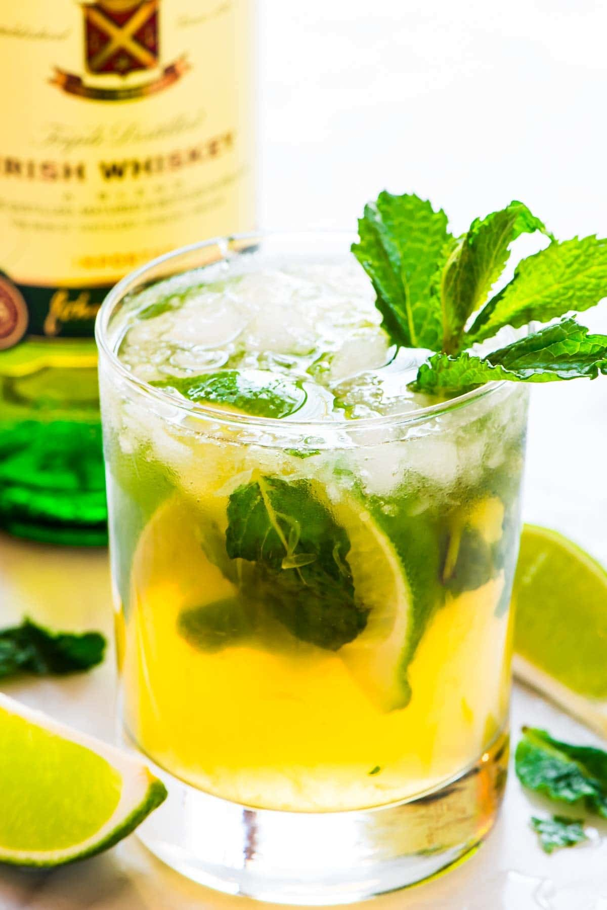 Swap lemon for lime in classic whiskey smash cocktails, and you have a GREEN Whiskey Smash for St. Patrick's Day! Recipe at wellplated.com | @wellplated