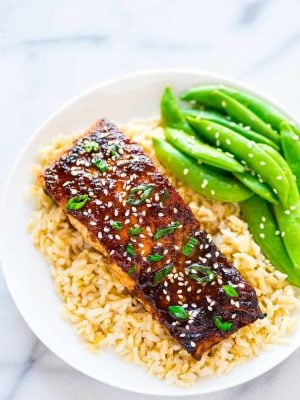 Easy Soy Ginger Salmon – a quick and easy recipe for busy weeknight dinners. Simple baked salmon, topped with a honey soy ginger glaze. Recipe at wellplated.com | @wellplated