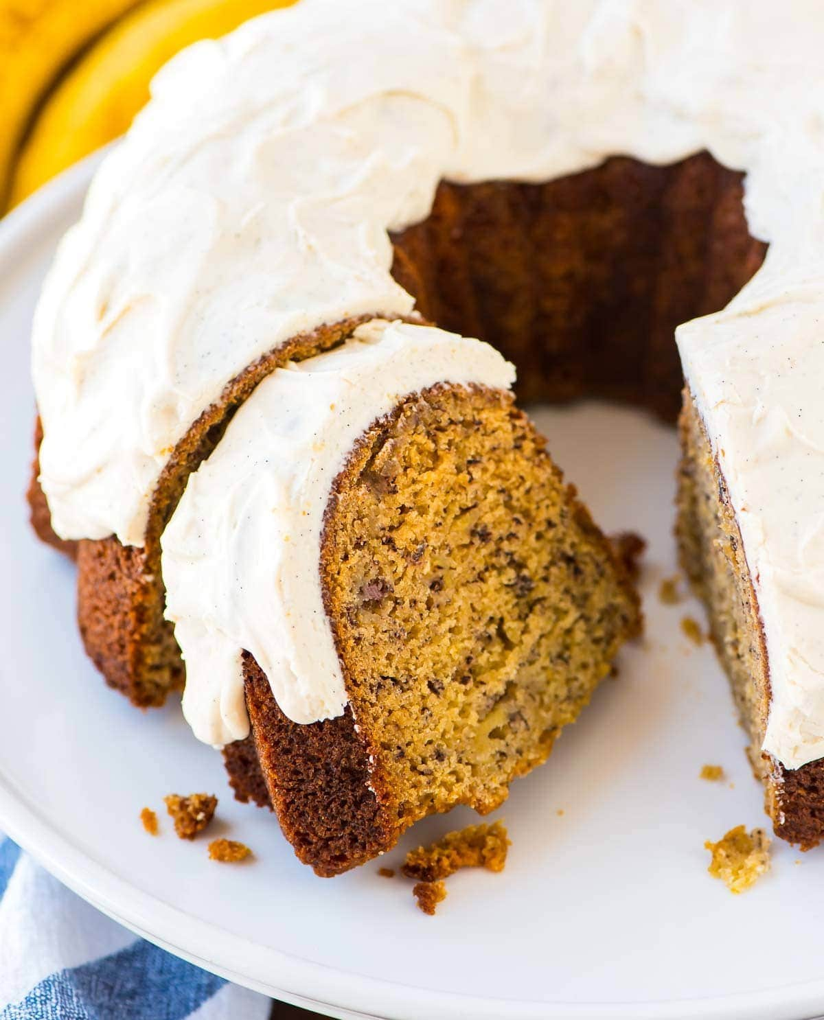 Exceptionally moist, flavorful Banana Bundt Cake with Vanilla Bean Cream Cheese Glaze. Easy recipe made with Greek yogurt, so it's a little healthy but it still tastes indulgent. This is the BEST banana cake you'll ever bake! Recipe at wellplated.com | @wellplated