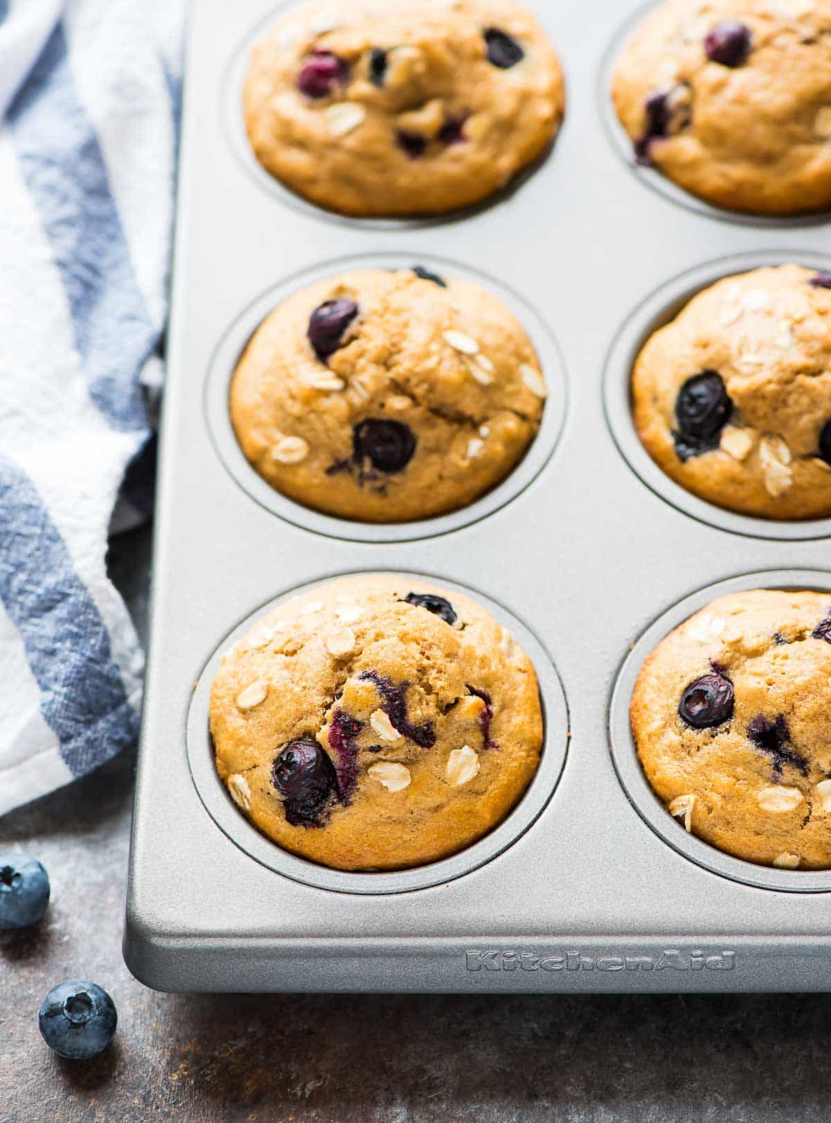 Healthy Blueberry Muffins with oatmeal and whole wheat flour. Low calorie, and bursting with fresh berries! An easy, healthy recipe that's perfect for toddlers AND adults. Recipe at wellplated.com | @wellplated