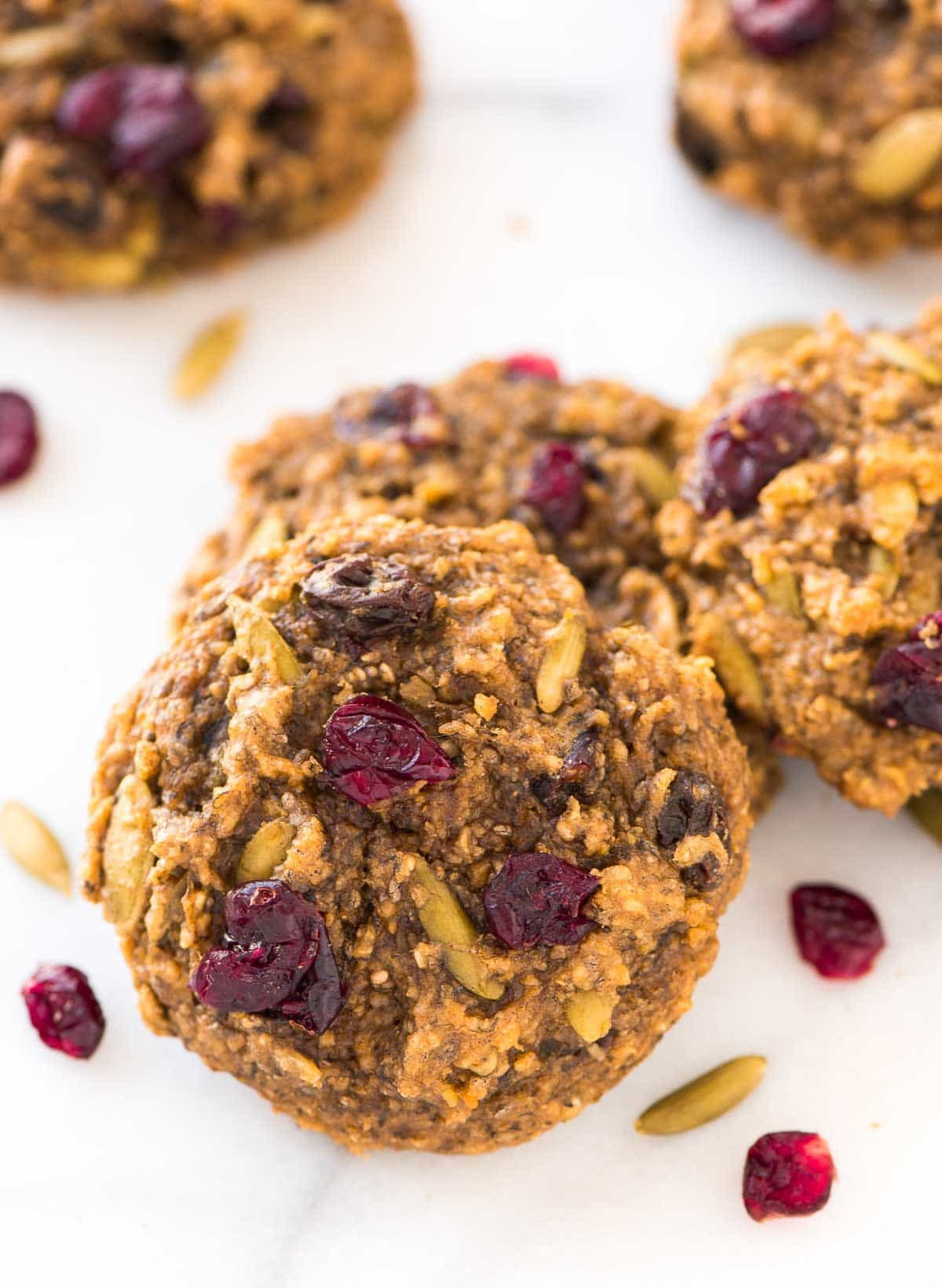 Peanut Butter Protein Cookies with banana, pumpkin seeds, and oatmeal. Add chocolate chips or any of your favorite mix-ins! Easy and gluten free. Recipe at wellplated.com | @wellplated