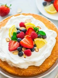 Flourless Lemon Almond Cake with Fresh Berries – a light, fluffy, and gluten free dessert made with almond flour, eggs, and sugar. Simple, low carb, and perfect for any holiday or party! Recipe at wellplated.com   @wellplated
