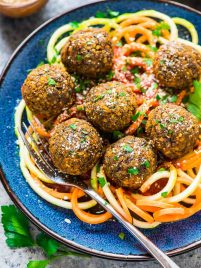 Easy Vegetarian Lentil Meatballs - Simple, healthy and protein packed! Made with cooked lentils, carrots, and lots of Italian spices, then oven baked. Perfect for filling meatless meals, and they taste great leftover too! Recipe at wellplated.com | @wellplated
