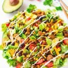 Skinny Taco Salad with ground turkey, black beans, veggies, and Greek yogurt salsa dressing. Tastes AMAZING, easy to make, and low carb. Perfect for fast, healthy lunches, weeknight dinners, and meal prep! Recipe at wellplated.com | @wellplated