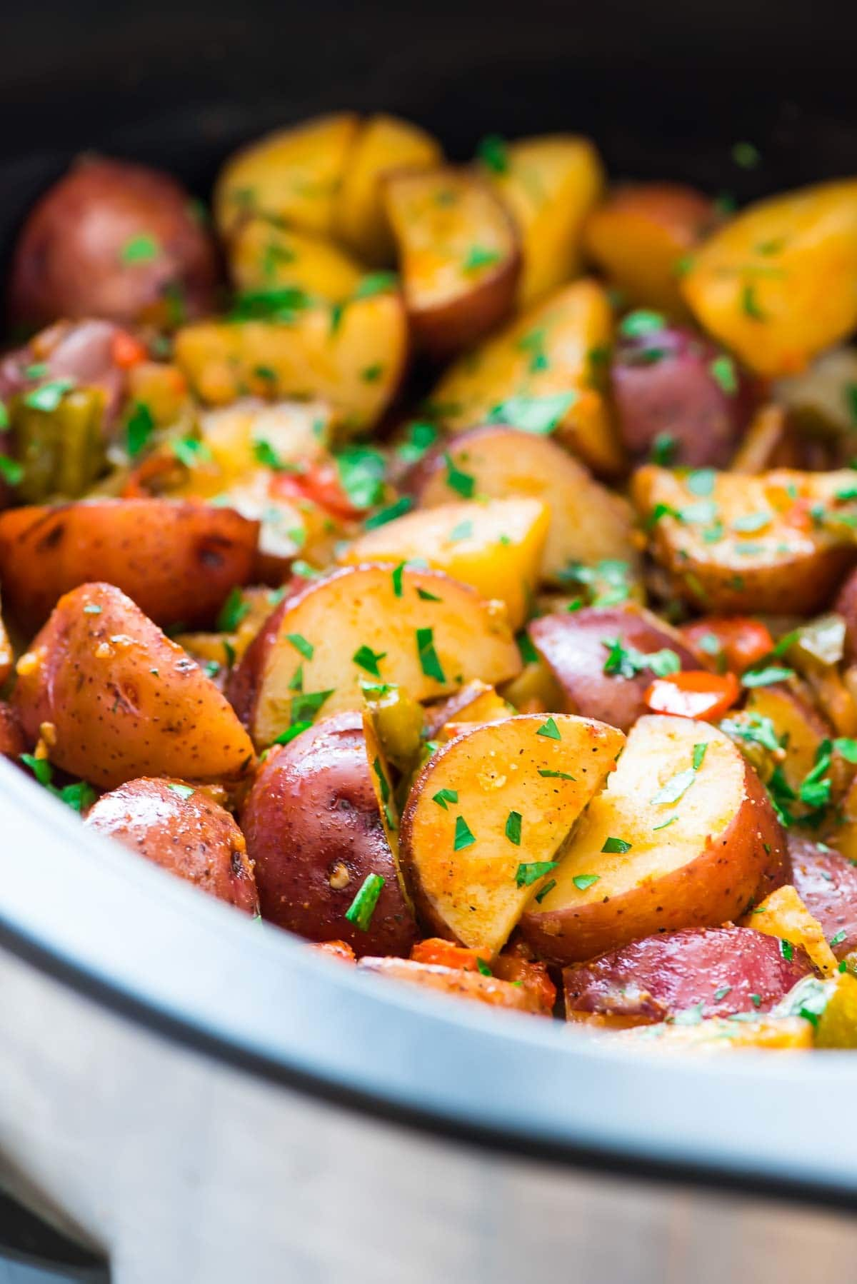Easy Crockpot Breakfast Potatoes – Crispy, tender potatoes with peppers, and onions. A better way to make home fries! Recipe at wellplated.com | @wellplated