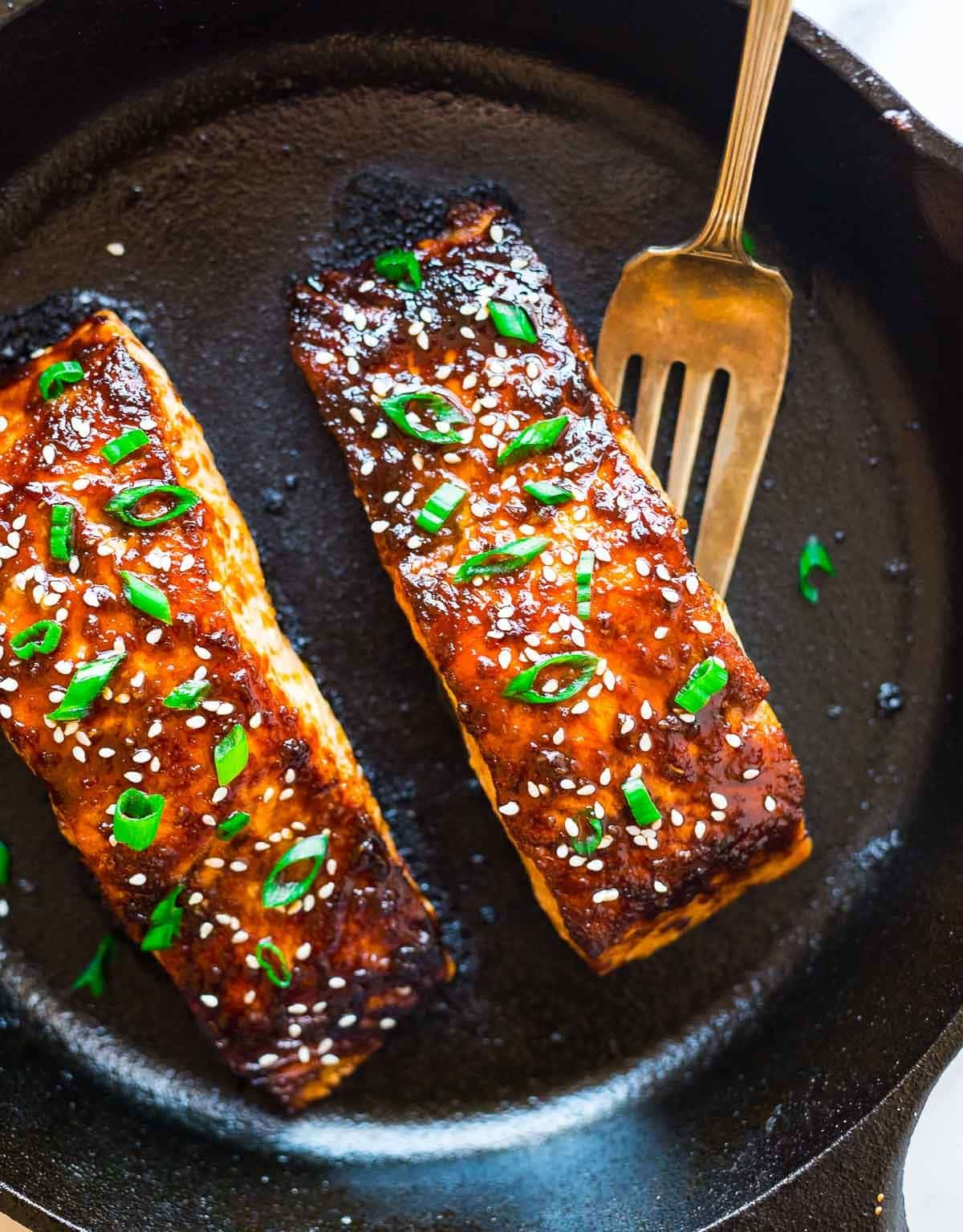 Soy Ginger Salmon – Easy baked salmon, topped with a honey soy ginger glaze. Perfect every time! Recipe at wellplated.com | @wellplated