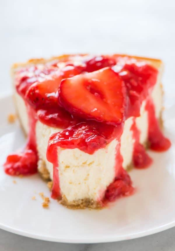 Skinny Lemon Yogurt Cheesecake with Strawberry Sauce. Light, fluffy, and so easy! Recipe at wellplated.com | @wellplated
