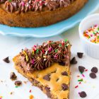 Ultra soft, ultra chewy Chocolate Chip Cookie Cake from scratch! The BEST recipe. EASY and the rich chocolate fudge frosting tastes incredible. Decorate for a special homemade birthday dessert or just enjoy a giant slice. Recipe at wellplated.com | @wellplated