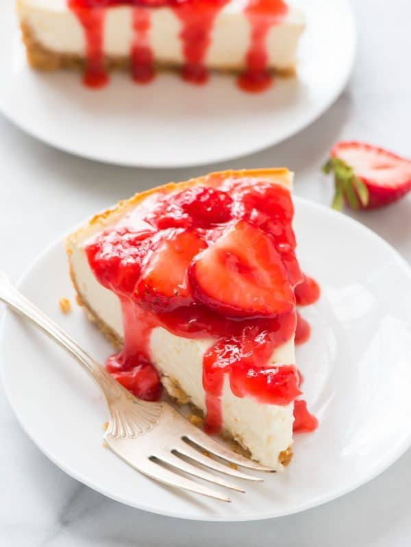New York Style Greek Yogurt Cheesecake. Light and fluffy with an easy fresh strawberry sauce. The only cheesecake recipe you need! Recipe at wellplated.com | @wellplated