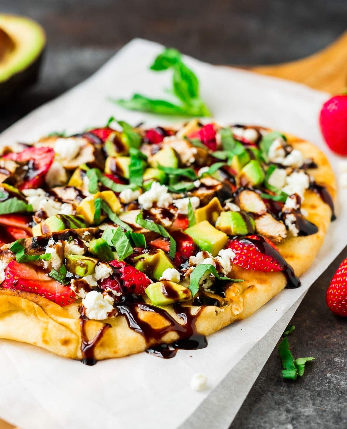 Easy Naan Pizza on the Grill with Strawberry, Chicken, Avocado, and Goat Cheese. Try this with any of your favorite pizza toppings! Recipe at wellplated.com | @wellplated