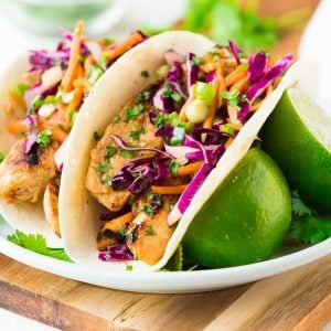 Easy marinated Ginger Chicken Tacos, grilled to perfection and topped with a crunchy Asian slaw. Quick, healthy and SO delicious! Recipe at wellplated.com | @wellplated