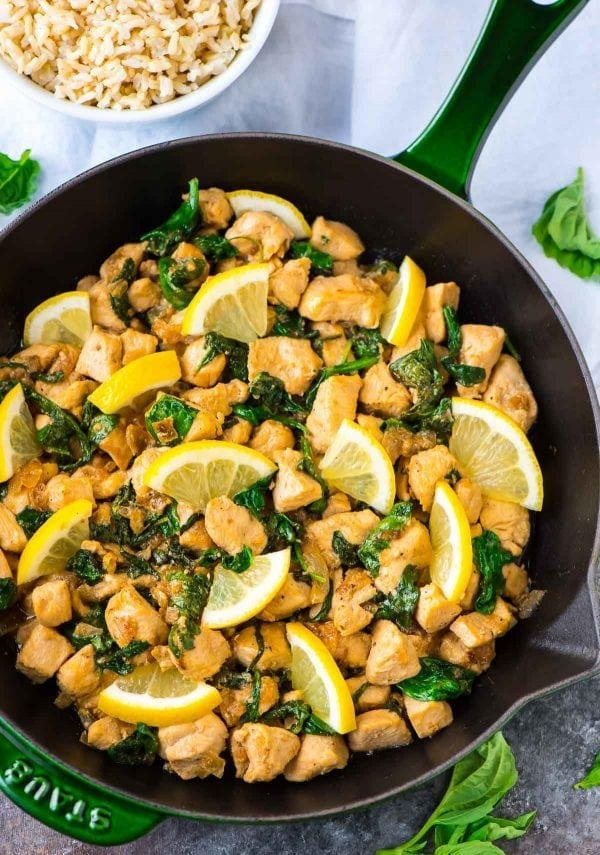 One Pan of Lemon Basil Chicken with Spinach and a side dish of fluffy brown rice