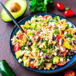 Creamy Mexican Pasta Salad with corn, black beans, avocado, and a delicious Greek yogurt dressing made with chili and lime juice. Easy, healthy, and always a favorite! Perfect picnics, potlucks, or a light summer dinner. Recipe at wellplated.com | @wellplated