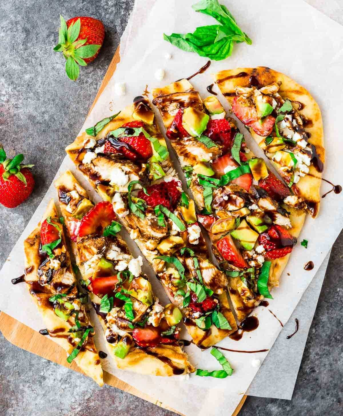 Easy Grilled Naan Pizza with Strawberry, Avocado, Balsamic Chicken, and Goat Cheese. The perfect light summer meal! Naan flatbread makes this recipe super quick and easy and the combination of flavors is AMAZING. Recipe at wellplated.com | @wellplated