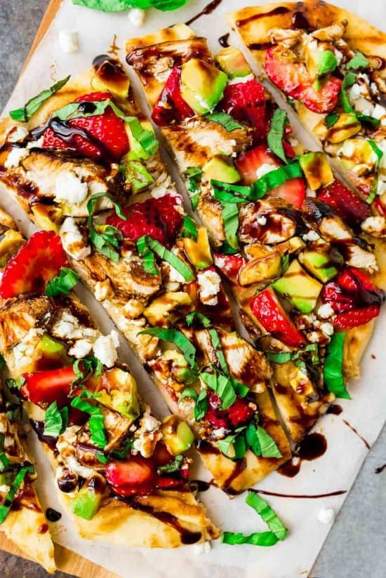 Naan Pizza with Strawberry, Chicken, Avocado and Goat Cheese. Our favorite way to grill pizza! Quick, easy, healthy, and so delicious. Recipe at wellplated.com | @wellplated