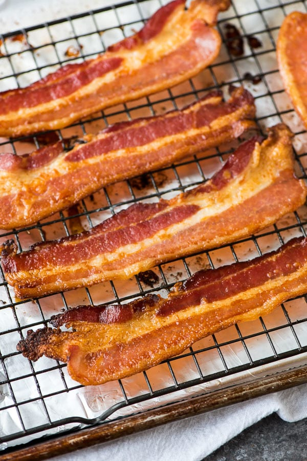 How to make PERFECT Baked Bacon in the oven. Easy and so crispy! Recipe at wellplated.com | @wellplated
